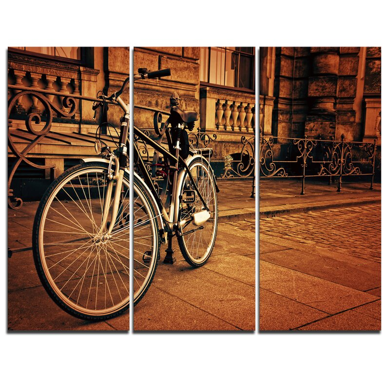designart retro bicycle against stone wall 3 piece graphic art on