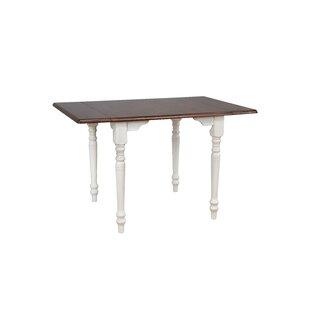 August Grove Kenya Drop Leaf Solid Wood Dining Table
