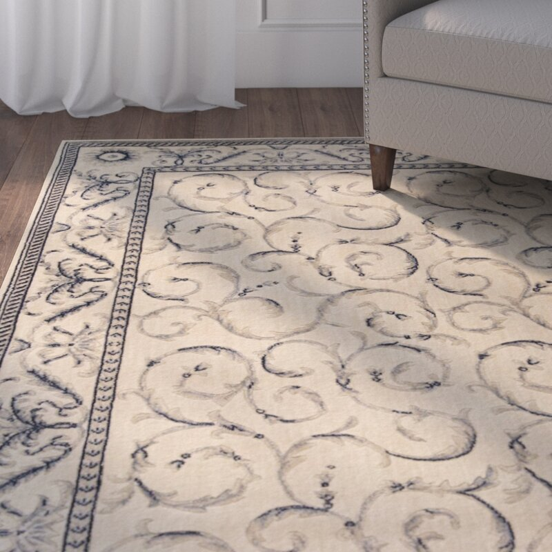 Dalrymple Power Loom Ivory Blue Area Rug