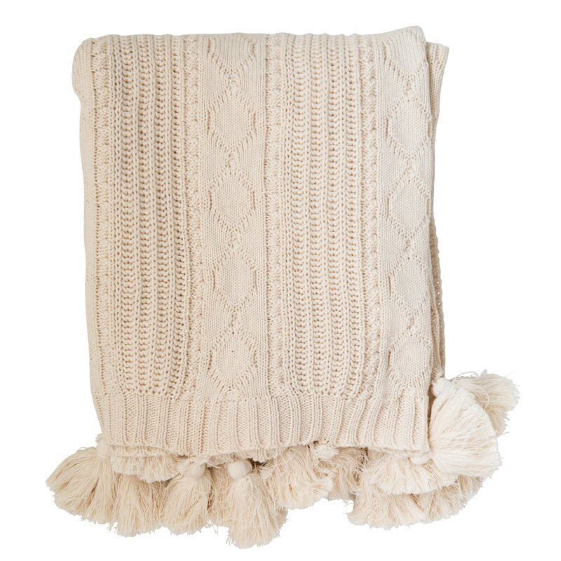 Lavonia Chunky Cable Knit Cotton Throw - Come discover more French Farmhouse Decor inspired by Fixer Upper and click here to Get the Look of The Club House Kitchen & Sun Room. #fixerupper #joannagaines #kitchendecor #frenchfarmhouse