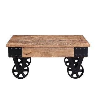 Hinnenkamp Solid Wood Wheel Coffee Table By Millwood Pines