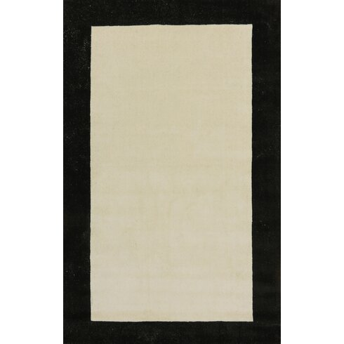 Manhattan Ivory Solid Bordered Area Rug