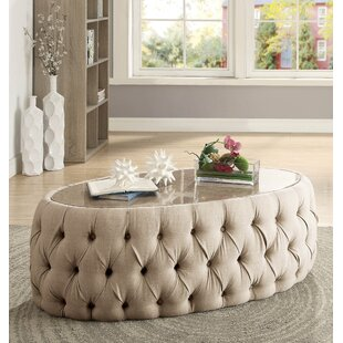 Everly Quinn Regan Oval Upholstered Coffee Table