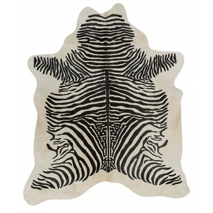 Best Stenciled Brazilian Cowhide Zebra with Spine Black/White Area Rug By Pergamino