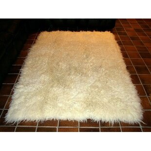 Compare & Buy Hera Flokati Extra Natural White Solid Area Rug By IXI