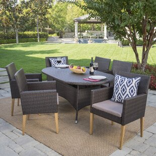 Lonnie Outdoor Wicker Rectangular 7 Piece Dining Set with Cushions
