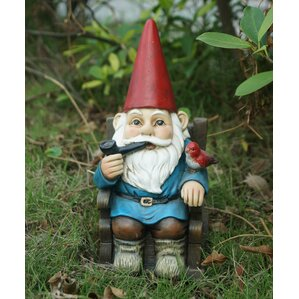 Gnome In Rocking Chair With Pipe And A Bird Statue