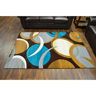 Mccampbell Hand Carved Turquoise Brown Area Rug