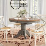 Wonderly Pedestal Extendable Solid Wood Dining Table by August Grove®