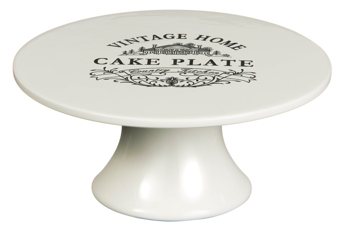 vintage ceramic cake stand in cream