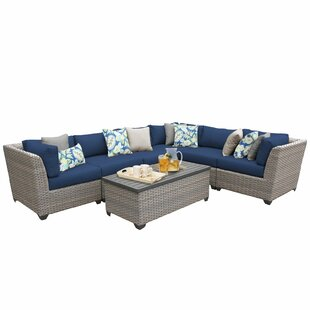 Meeks 7 Piece Rattan Sectional Seating Group with Cushions