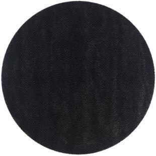 Rowen Black Area Rug by Wade Logan