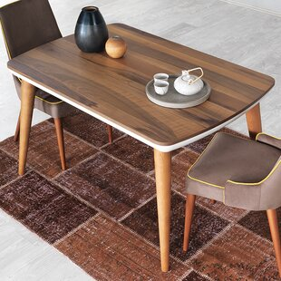 Shaunta Stable Dining Table