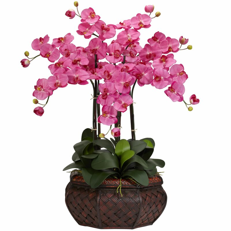 large silk flower arrangement in dark pink