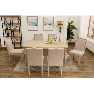 Edeline Country Styled 7 Piece Dining Set With Round Carved Legs