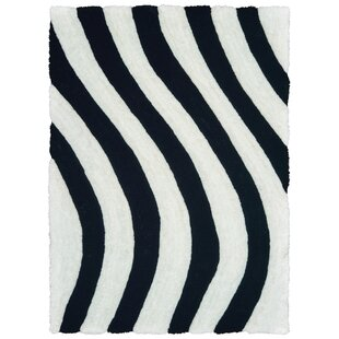 Best Reviews Fitts Jet Black/Pure White Area Rug ByWrought Studio