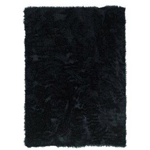 Shopping for Samantha Hand-Tufted Faux Sheepskin Black Area Rug By Threadbind