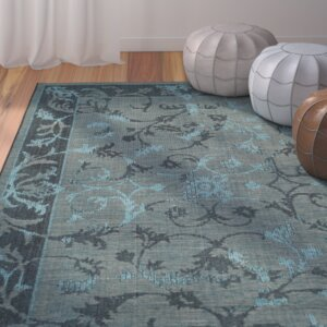 Mahmoud Black and Turquoise Area Rug