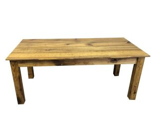 Solid Wood Dining Table by Ezekiel and St..