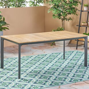 Places to buy  Nydia Wooden Dining Table Price & Reviews