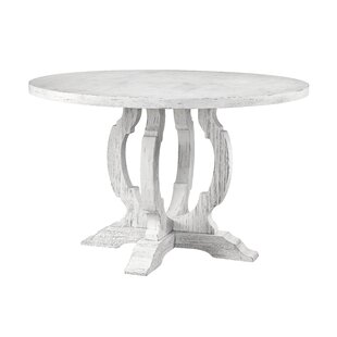 Caigan Solid Wood Dining Table Ophelia & Co.