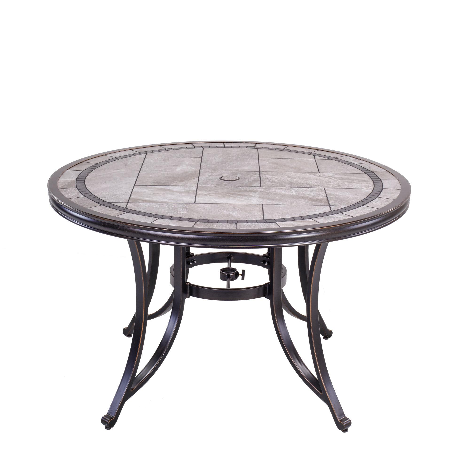 Fleur De Lis Living 46 Round Patio Table With Handmade Porcelain Top And Heavy Duty Frame Reviews Wayfair