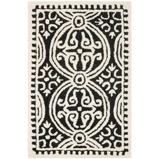 Fairburn Hand-Tufted Wool Black/Ivory Area Rug by House of Hampton