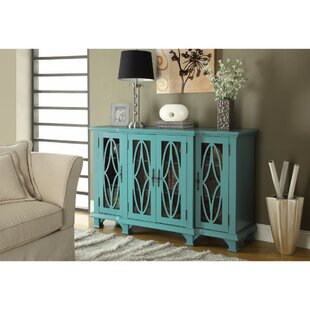Hippocrates 4 Door Accent Cabinet by August Grove