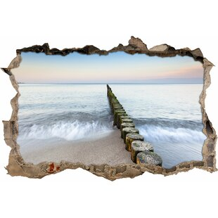 Row Of Bamboo Stumps By The Sea Wall Sticker By East Urban Home
