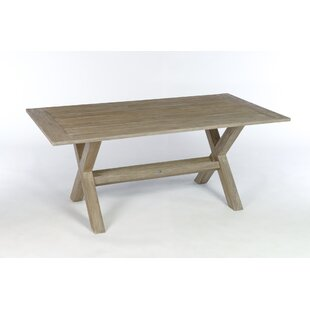 Earnest Solid Wood Dining Table by Rosecliff Heights