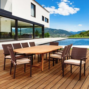 Arango 11 Piece Teak Dining Set with Sunbrella Cushions