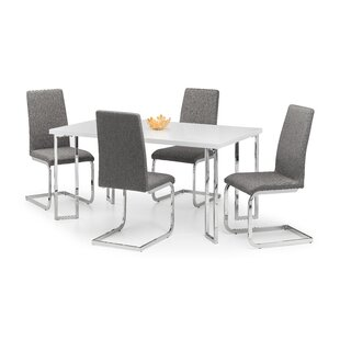 Koutney Dining Set With 4 Chairs By Metro Lane