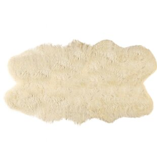 Compare prices Ulverst Cowhide Chocolate/White Area Rug By Everly Quinn