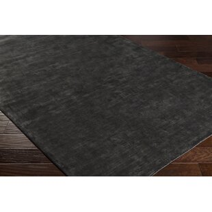 Ayala Hand-Loomed Black Area Rug by Orren Ellis
