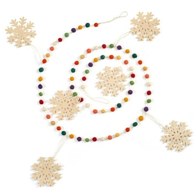 Bright, colorful, little dots wind around your tree like a string of candy gumballs. Large white snowflakes in hand-felted wool add the traditional wintry notes. Sugar-free. Each design is as unique as the artisan who creates it. This product is hand-felted designs are hand-felted, hand appliqued, and lovingly created from 100% sustainable wool by artisans working in India. The facility where these pieces are produced is an award-winning model of sustainability, which runs on solar electricity, collects rainwater, and recycles water on-site. By collaborating with this artisan group, product is helping to preserve the tradition of felt making in the area, promote eco-friendly business, and provide fair and safe employment for hundreds of artisan felt-makers, sheepherders, and seamstresses. Our artisans are experts in their craft - creating the heirloom of tomorrow. Dimensions: Approximately 6\'. As an artisan product, size may vary slightly. Arcadia Home