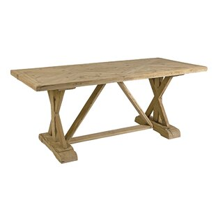 Alrik Solid Wood Dining Table by One Alli..