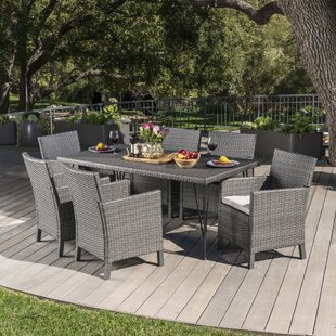 Orren Ellis Luray Outdoor Wicker 7 Piece Dining Set with Cushions