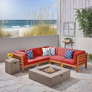 Neil Outdoor V-Shaped 7 Piece Sectional Seating Group with Cushions