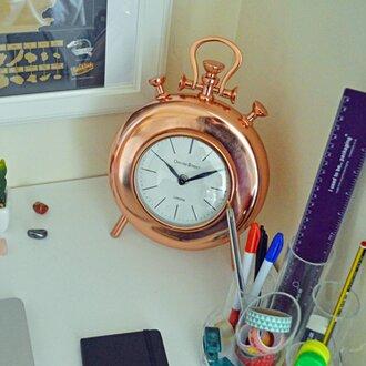 closeup of a giant copper analog desk clock