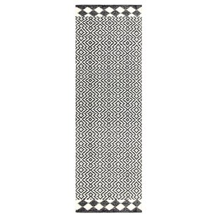 Odeon Hand-Woven Black Indoor/Outdoor Area Rug