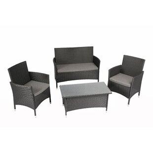 Ebern Designs Patillo Outdoor Complete 4 Piece Rattan Sofa Set with Cushions