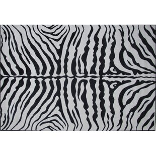 Order Supreme Zebra Skin Machine Woven Black/White Area Rug By Fun Rugs