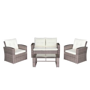 Ebern Designs Govea 4 Piece Rattan Deep Seating Group with Cushions
