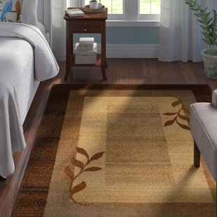 Find the perfect Eugenia Brown Area Rug By Andover Mills