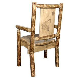 Loon Peak Rivas Captain's Solid Wood Dining Chair with Laser Engraved Wolf Design