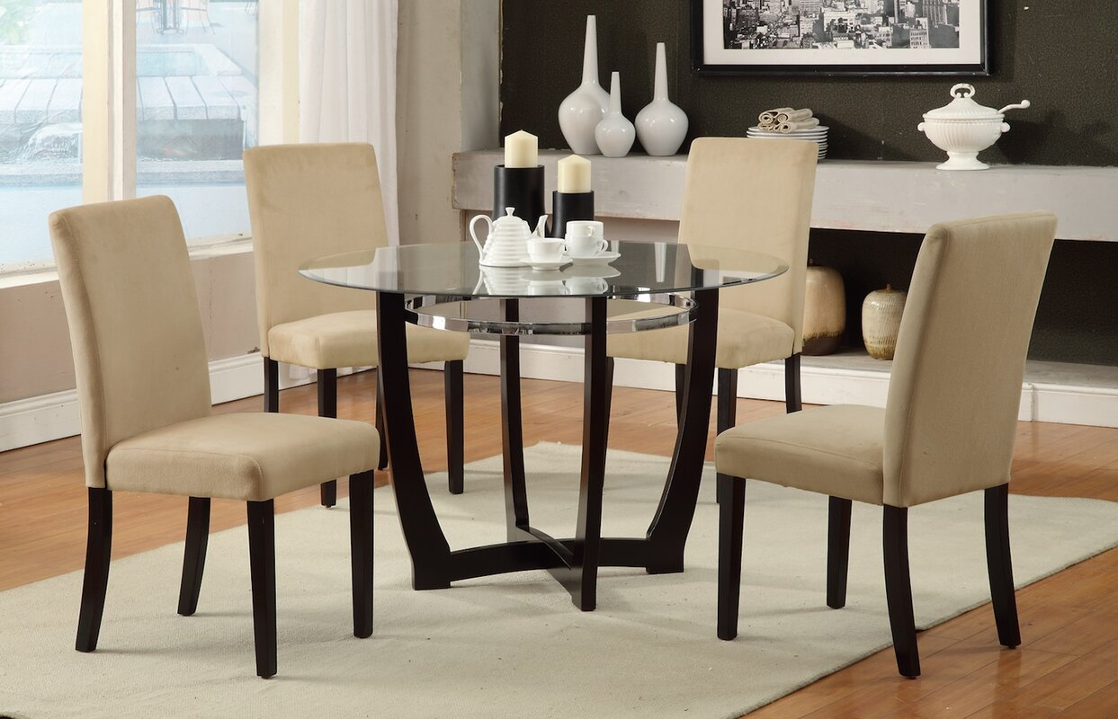 The cube medium table and 4 chairs is also available in a light finish - 5 Piece Dining Set