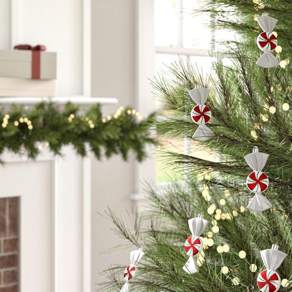 Oval shaped plastic hunting theme Christmas ornament