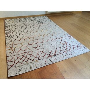 Amazon Cream Rug by World Menagerie