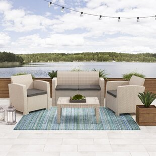 Faris 4 Piece Rattan Sofa Seating Group Set with Cushions