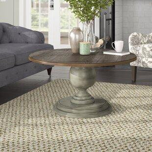 Serpentaire Round Pedestal Coffee Table Lark Manor